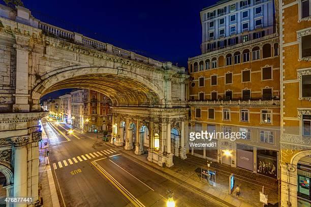 Italy, Genoa, Shopping street Via XX Settembre with Ponte Monumentale at night