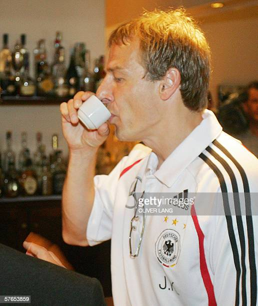 Germany's national team's head coach Juergen Klinsmann drinks a coffee in a bar prior giving a press conference 19 May 2006 at the Hotel Is Morus in...