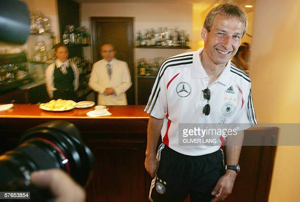 Germany's national team's head coach Juergen Klinsmann stands in a bar prior giving a press conference 19 May 2006 at the Hotel Is Morus in Pula on...