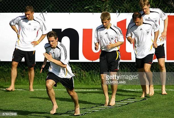 Germany's national team's players Lukas Podolski Miroslav Klose Thomas Hitzlsperger Jens Nowotny and Per Mertesacker train 17 May 2006 at the at the...