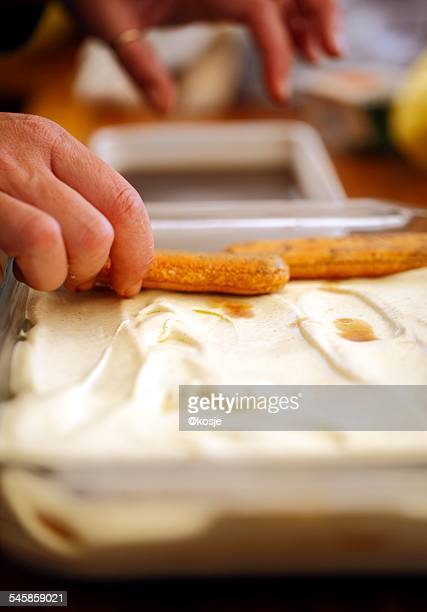 italy, hand of man preparing tiramisu - mascarpone cheese stock pictures, royalty-free photos & images