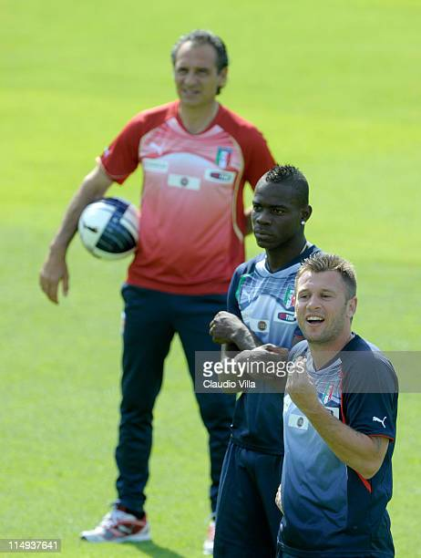 Italy head coach Cesare Prandelli, Mario Balotelli and Antonio Cassano of Italy during a training session at Coverciano on May 30, 2011 in Florence,...
