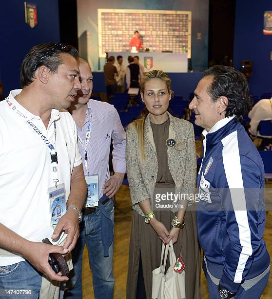 Italy head coach Cesare Prandelli Novella Benini and friends talk during a press conference ahead of the UEFA EURO 2012 Final against Spain at Casa...