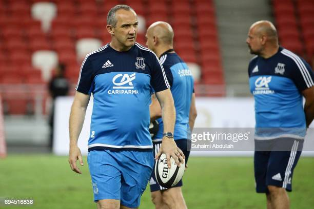 Italy head coach Conor O'Shea joins the warm up during the International Test match between Italy and Scotland at Singapore Sports Stadium on June 10...