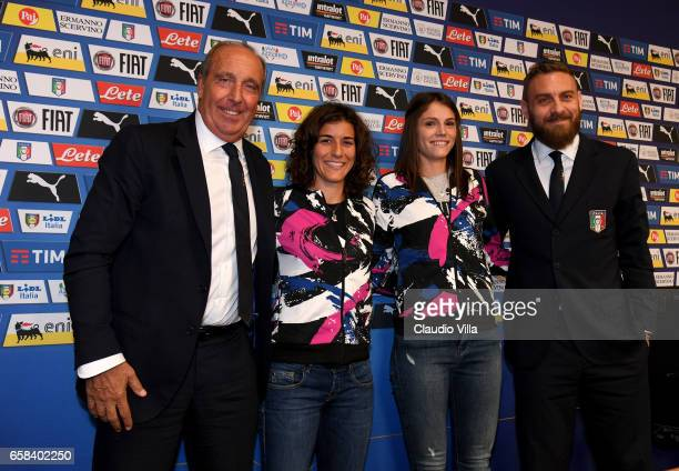 Italy head coach Gian Piero Ventura and Daniele De Rossi pose with Marta Carissimi and Cecilia Salvai of the Italy women's national football team at...