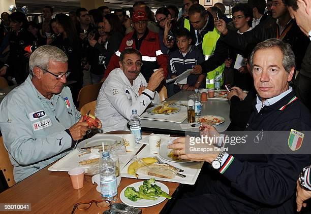 L'AQUILA ITALY NOVEMBER 12 Italy head coach Marcello Lippi and Guido Bertolaso dine during the Italy National soccer team visit to earthquake striken...