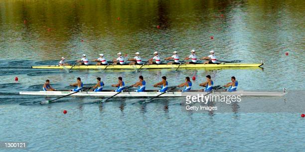 Italy in blue and Germany in white in action in the mens eight heats during the 2002 World Rowing Junior Championships on Lake Galve in Trakai,...