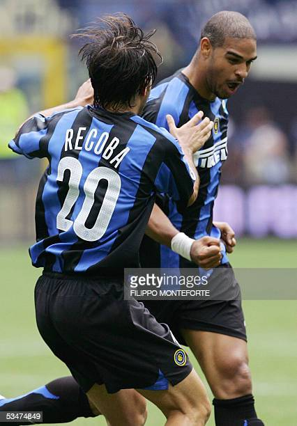 Inter Milan Adriano of Brazil celebrates with his teammate Alvaro Recoba of Uruguay after scoring his first goal during their italian serie A...