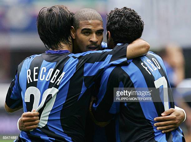 Inter Milan Adriano of Brazil celebrates with his teammates Alvaro Recoba of Uruguay and Luis Figo of Portugal after scoring his first goal during...