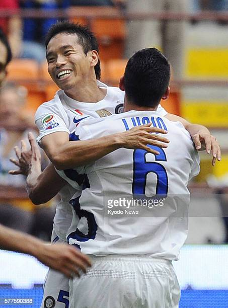 MILAN Italy Inter Milan defender Yuto Nagatomo celebrates with teammate Lucio after scoring during a Serie A soccer game against Catania in Milan...