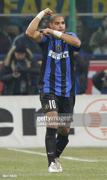 Inter Milan's forward Adriano of Brazil celebrates after scoring a penalty against AC Milan during their italian serie A football match at San Siro...