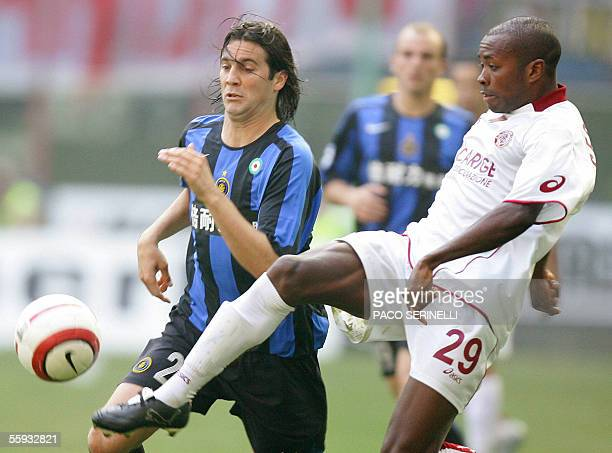 Inter Milan's midfielder Santiago Solari of Argentina fights for the ball with Livorno's midfielder Cesar Prates of Brazil during their serie A...