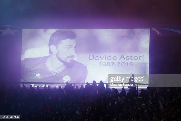 Italy international Davide Astori who passed away earlier in the week is seen on the scoreboard as he is remembered prior to the UEFA Champions...