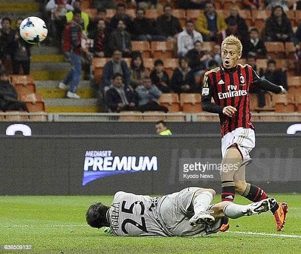MILAN Italy Japanese footballer Keisuke Honda of AC Milan fires over Chievo Verona goalkeeper Michael Agazzi in a Serie A game against in Milan on...