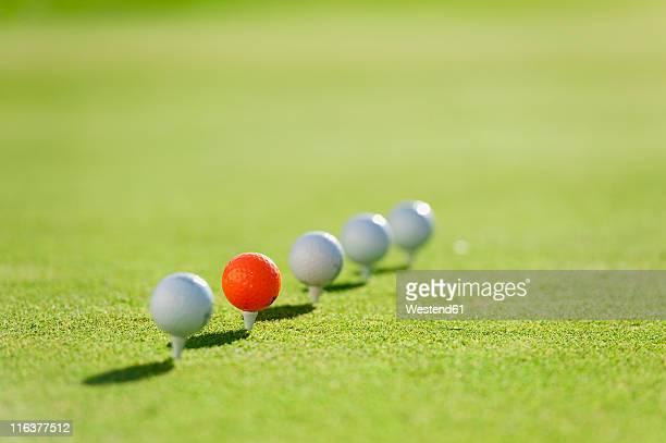 italy, kastelruth, golf balls on golf course - ゴルフのティー ストックフォトと画像