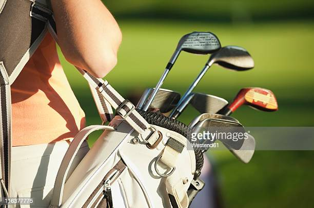 Italy, Kastelruth, Mid adult woman with golf bag, close up