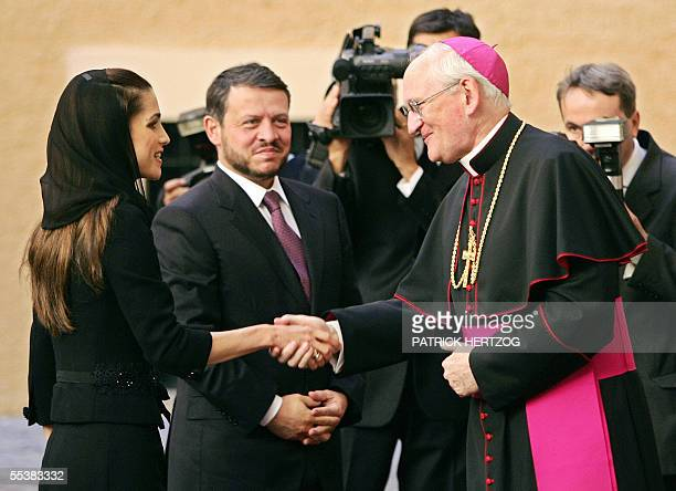 King Abdullah II and Queen Rania of Jordan are welcomed by US bishop James Harvey before a meeting with Pope Benedict XVI 12 September 2005 at his...