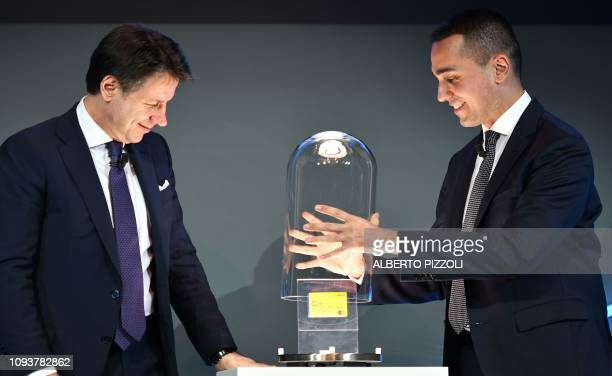 Italy Labor and Industry Minister and deputy Luigi Di Maio and Italy's Prime Minister Giuseppe Conte unveil the first citizenship wage card at the...