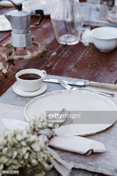 Italy, laid breakfast table on terrace
