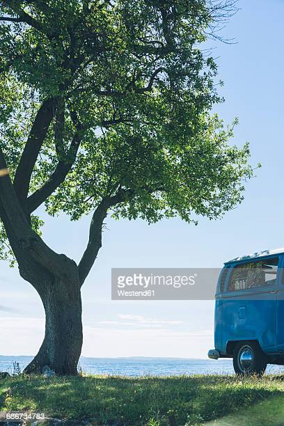 Italy, Lake Garda, camping bus at lakeshore