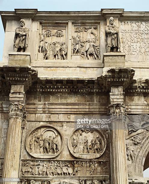 Italy Latium region Rome Imperial Fora Arch of Constantine 315 AD Detail relief of the attic of Marcus Aurelius Age between two statues medallions of...