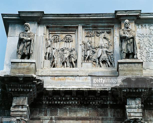Italy Latium region Rome Imperial Fora Arch of Constantine 315 AD Detail relief of the attic of Marcus Aurelius Age between two statues depicting...