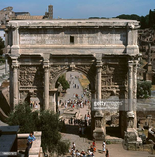 Italy Latium Rome Fori Imperiali Whole artwork viewTotal Triple arch marked by four composite columns on high bases inscription dedicated to...