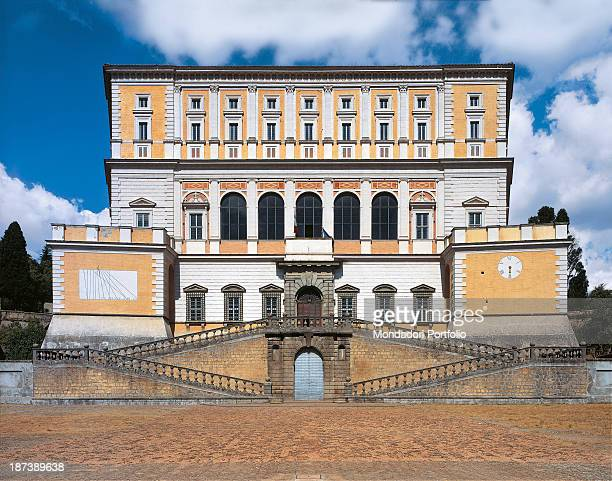 Italy Lazio Caprarola Palazzo Farnese All The façade of the elegant pentagonal plan building with the imperial staircase pilasters and ashlar work