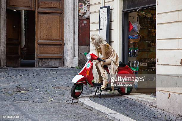 Italy Lazio Rome Mannequin seated on Vespa outside tourist shop