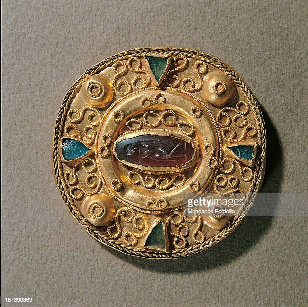 Italy Lazio Rome Museo dell'Alto Medioevo All Disc fibulae signs of the Romanization of Longobard tradition Filigree in Byzantine technique and...