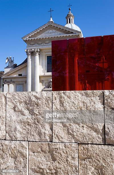 Italy Lazio Rome Neo Classical Church of San Rocco and red perspex cube behind a stone wall at the Ara Pacis