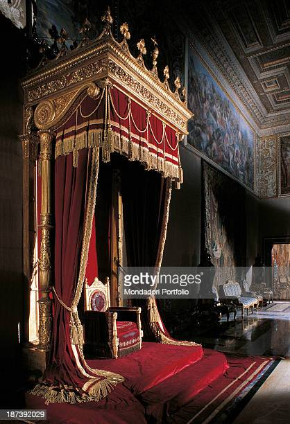 Italy Lazio Rome Palazzo del Quirinale All Throne under a canopy with a red and golden decoration A red carpet on the floor