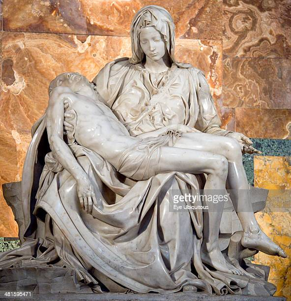 Italy, Lazio, Rome, Vatican City The 1499 Renaissance Pieta by Michelangelo in St Peters Basilica depicting the body of Jesus in the arms of his...