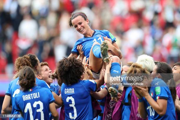 Italy lift Barbara Bonansea in the air as they celebrate her injury time winning goal after the final whistle during the 2019 FIFA Women's World Cup...