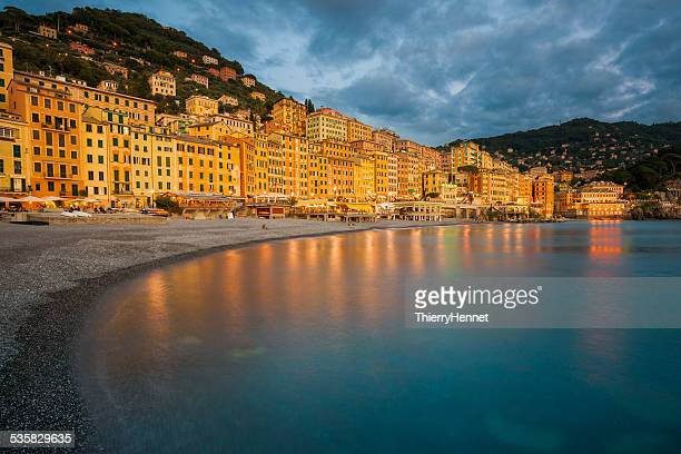 Italy, Liguria, Genoa, Camogli, Waterfront with electric lights reflecting in water
