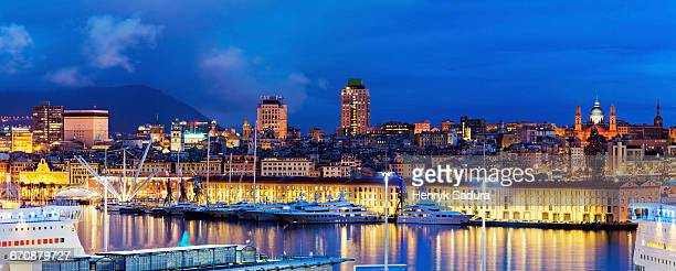 italy, liguria, genoa, panorama of harbor at dusk - genoa italy stock pictures, royalty-free photos & images