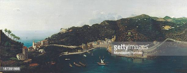 Italy Liguria Genoa Private collection All Panoramic view of the village of Portofino with its church its square and some boats moored at the pier of...
