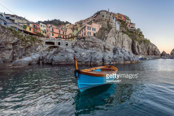 italy, liguria, la spezia, cinque terre national park, manarola, empty blue fishing boat - fishing village stock pictures, royalty-free photos & images