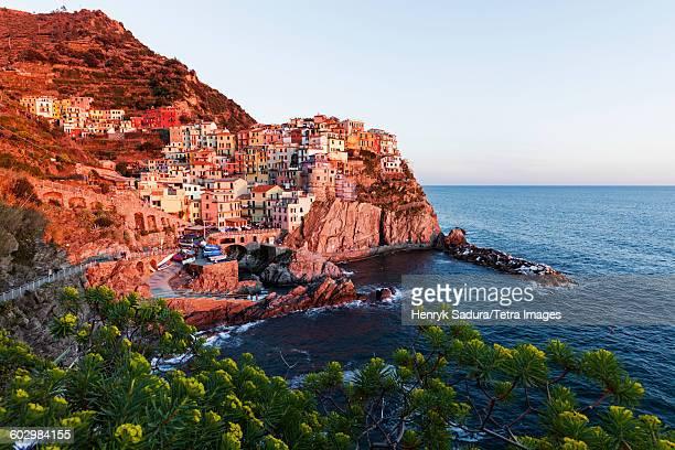 Italy, Liguria, Manarola, Coastal town at sunset