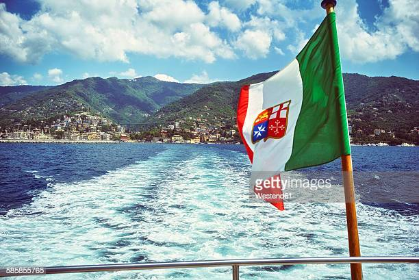 italy, liguria, rapallo, stern of a ship with genoese flag on the sea - heck stock-fotos und bilder