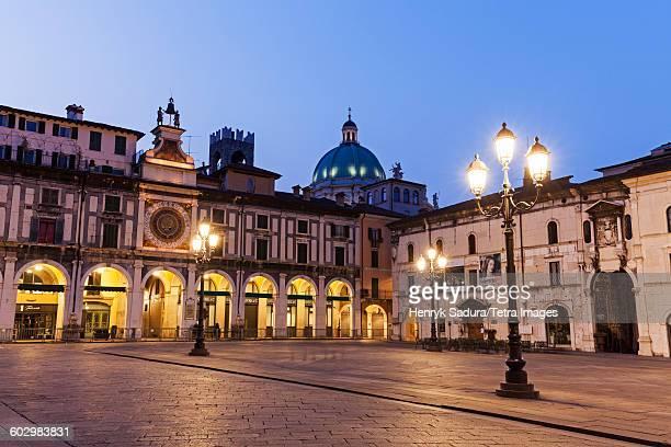 Italy, Lombardy, Brescia, Piazza della Loggia at dusk