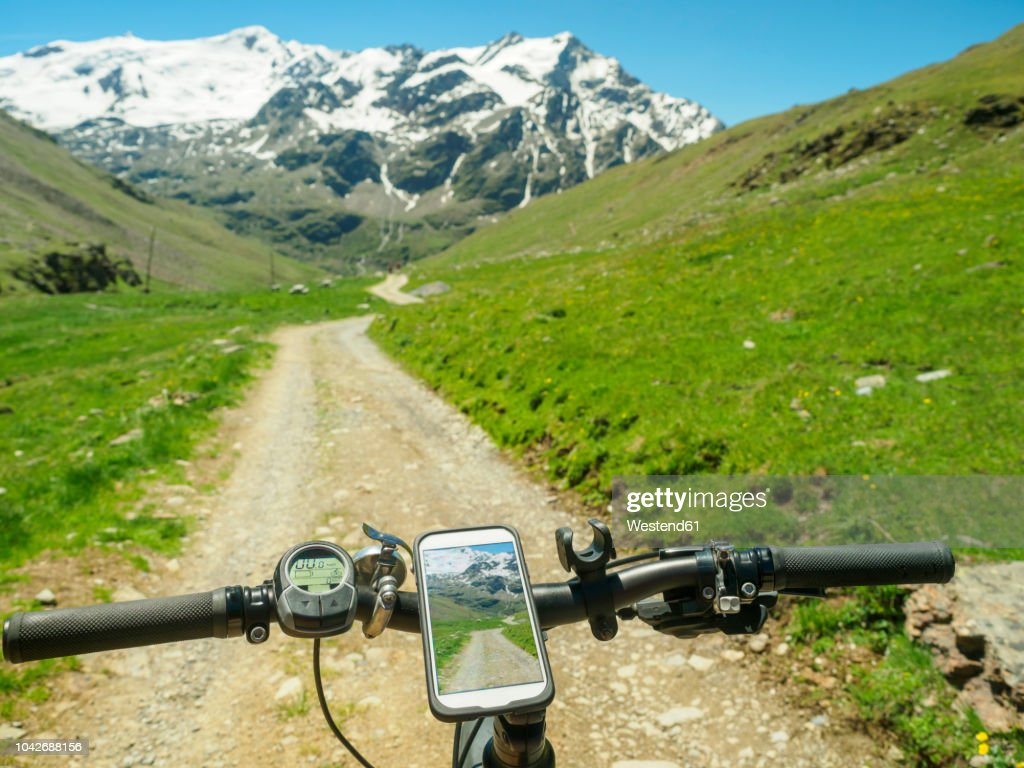 Italy, Lombardy, Cevedale Vioz mountain crest, cell phone on mountain e-bike : Stock Photo