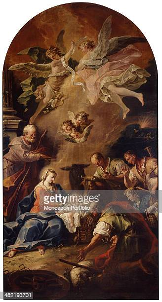 Italy, Lombardy, Clusone, Basilica. Whole artwork view. Shepherds in adoring Baby Jesus and the Holy Family; jubilant Angels in the upper part of the...