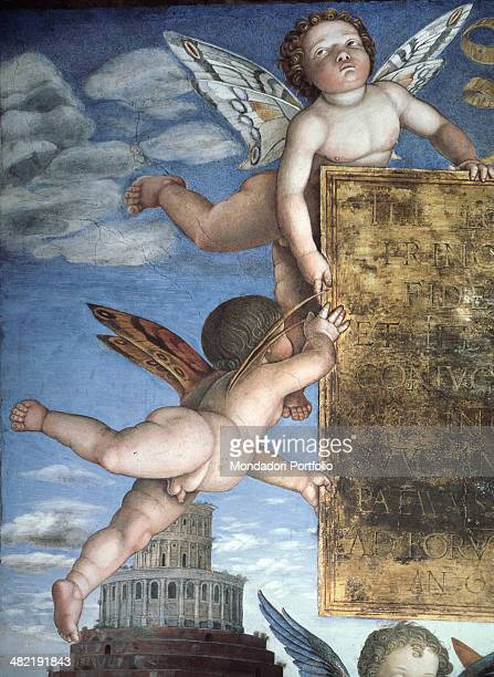 Italy Lombardy Mantua Ducale Palace Detail Putti with butterfly wings hold a plate a Renaissance building with a central map in the background