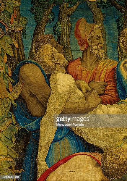 Italy Lombardy Milan Duomo Museum Detail In a garland of leaves and snakes two men are sustening an idolatrous