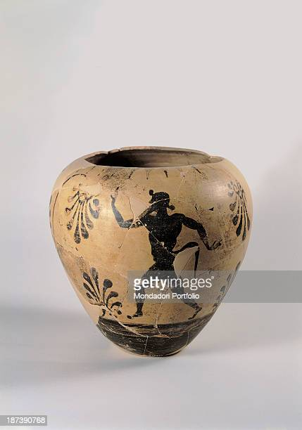 Italy Lombardy Milan Museo Archeologico Blackfigured amphora with a floral decoration and a man with a satyr's tail running possibly a God