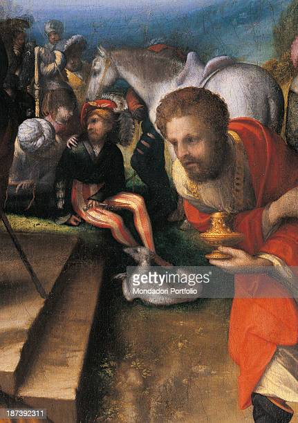 Italy Lombardy Milan Pinacoteca di Brera Detail One of the Three Kings kneeling He's offering a gift to Jesus In the background men with a horse and...