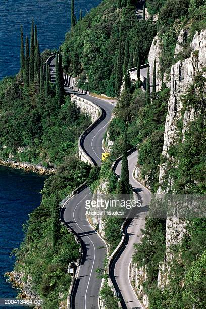 Italy, Lombardy, road along edge of Lake Garda, elevated view