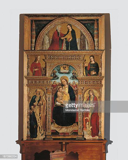 Italy Lombardy Vigevano Ospedali Civili All Altarpiece composed by a threefornix triumphal arch A lunette represents Enthroned Madonna who feeds the...