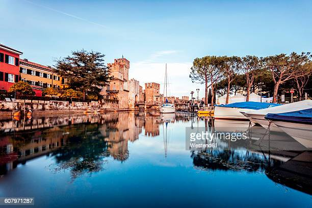 Italy, Lombary, Sirmione, Sailing ships at harbour